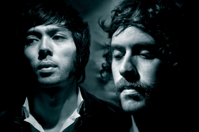Both members of the band Justice looking away from the camera
